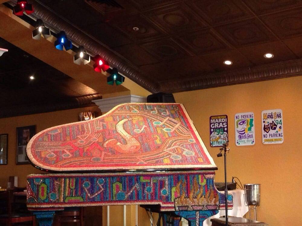 Ralph Brennan's Jazz Kitchen - Anaheim, CA, United States. Mardi Gras feel, the cool piano & signs