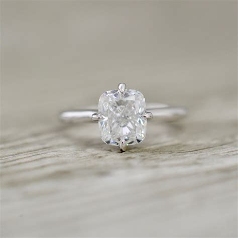 Hidden Halo Engagement Rings
