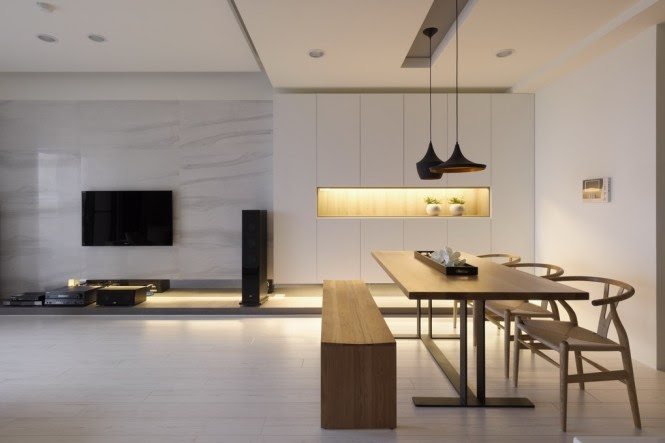 A letterbox of light flanks the dining place, creating ambient lighting as well as breaking a plain wall.
