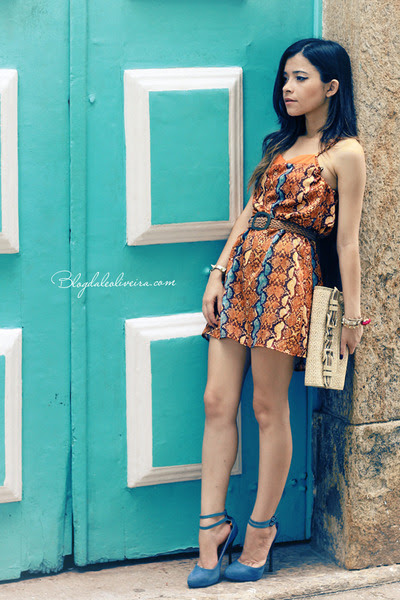 Light-orange-dress-sky-blue-dress-eggshell-bag