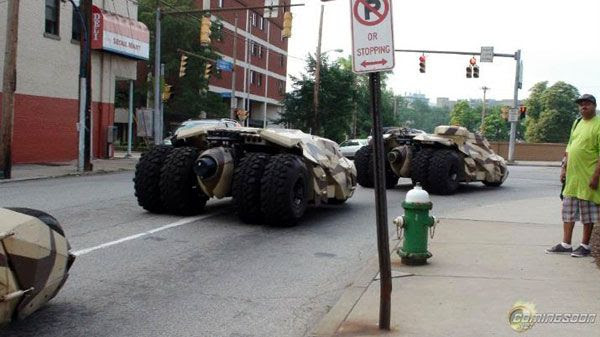 Three Tumbler stunt vehicles drive down the street during filming of THE DARK KNIGHT RISES.