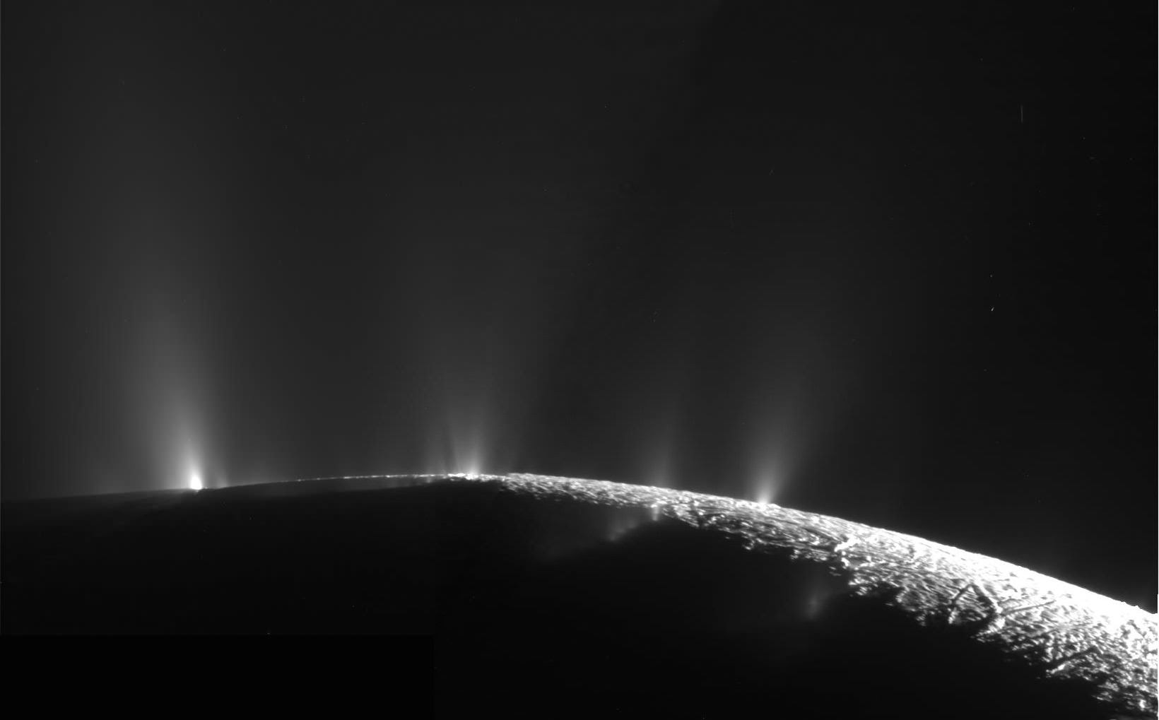 Icy water vapor geysers erupting from fissures on Enceladus. Credit: NASA/JPL