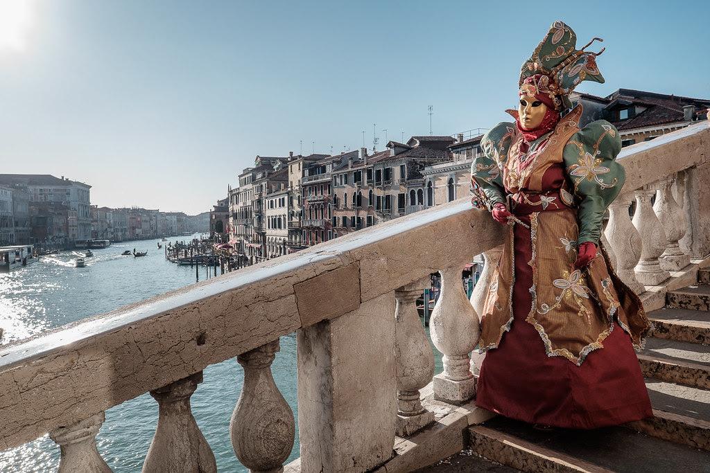 Masked Venetian on the Rialto Bridge