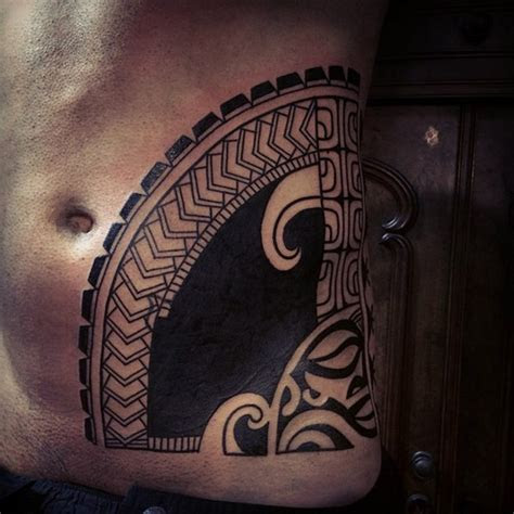aztec sun god blackwork tattoo  belly side  tattoo