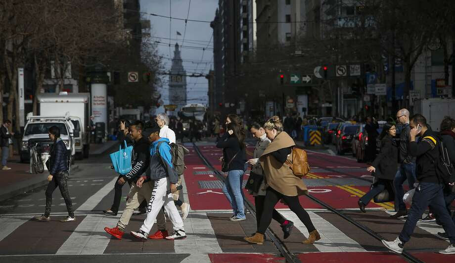 People cross Market St. between 4th and 5th Streets, in San Francisco, Calif. on Wed. January 13, 2016. The stretch of Market Street between 4th and 5th is one of the busiest in San Francisco, it also generates more crime reports than any other single block in the city. Photo: Michael Macor, The Chronicle