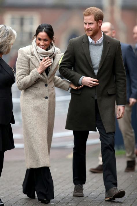 Meghan Markle sports messy bun and £593 coat for Brixton