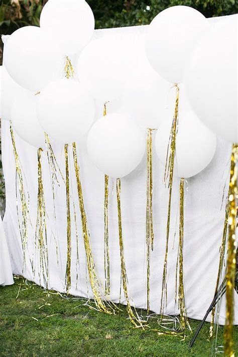 Beautiful white balloon display for an all white birthday