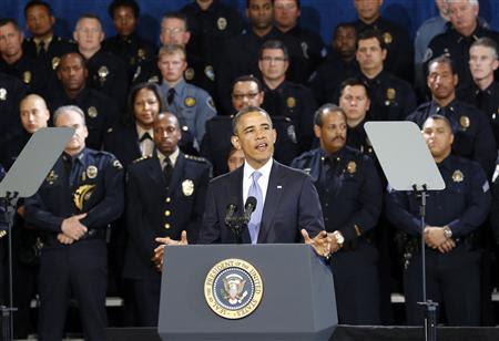 U.S. President Barack Obama speaks about tighenting gun regulations during a visit to the Denver Police Academy in Denver, Colorado April 3, 2013. REUTERS/Kevin Lamarque