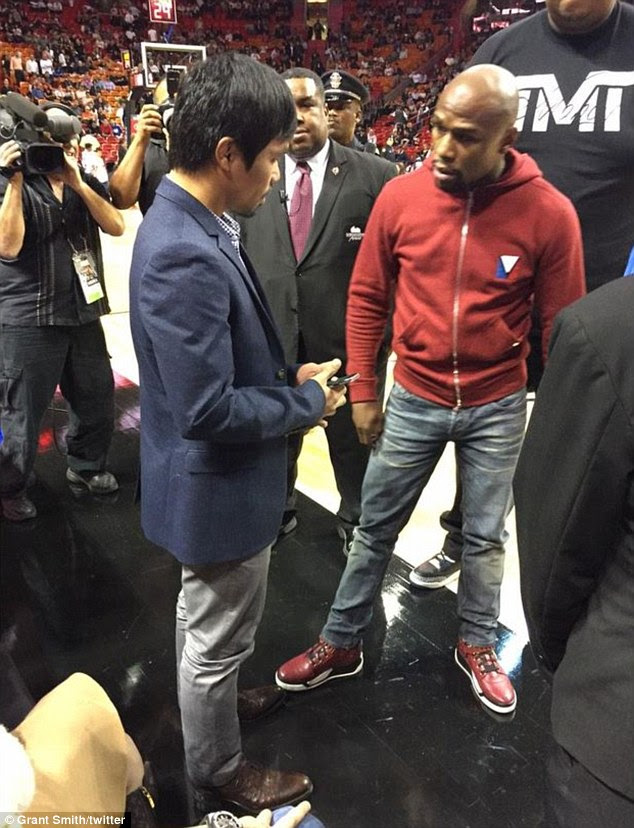 These pictures posted on Twitter show Manny Pacquiao (left) and Floyd Mayweather meeting in Miami
