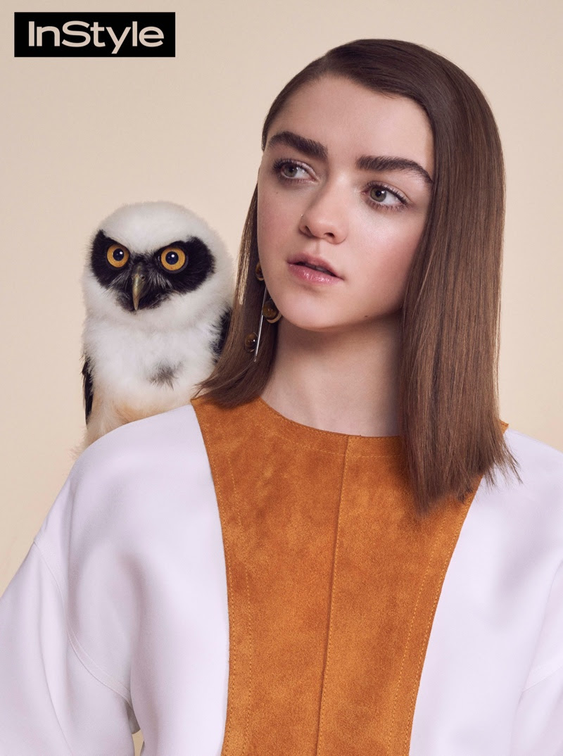 Photographed with an owl, the Game of Thrones actress wears a suede top