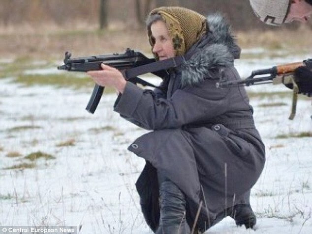 Ekaterina Bilyik, 68, undergoes automatic weapons training during an army drill in the snow