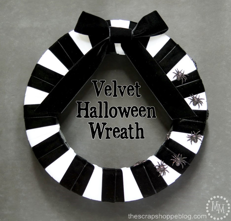 A black and white wreath is classic for Halloween. Make it striped and made with velvet ribbon and it's downright skeletal looking and has vintage look and feel!