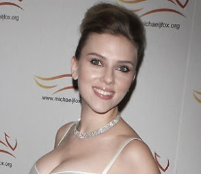 johansson wins breast battle