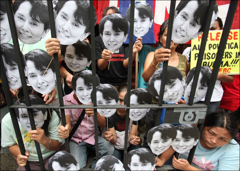 Protesters in Manila display portraits of Burmese pro-democracy leader Aung San Suu Kyi
