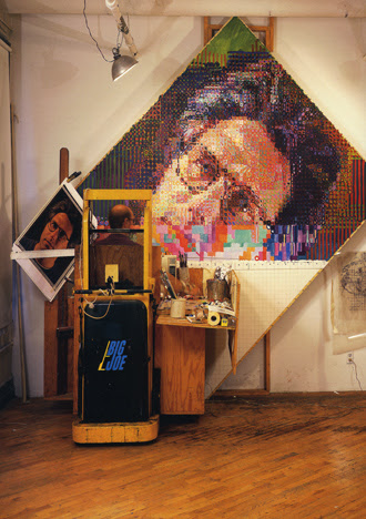 photo of Chuck Close working on his painted portrait of Eric, 1990