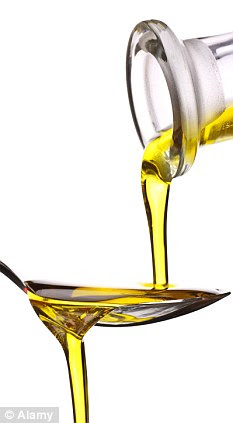 Two tablespoons of olive oil a day almost halves the risk of heart disease while one spoonful cuts the risk by 28 per cent