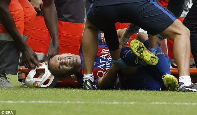 Iniesta clutched his knee tightly and looked to be visibly in agony