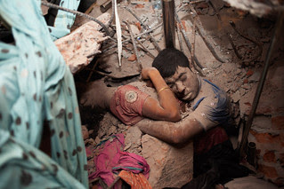 April 25, 2013. Two victims amid the rubble of a garment factory building collapse in Savar, near Dhaka, Bangladesh.  Read more: http://lightbox.time.com/2013/05/08/a-final-embrace-the-most-haunting-photograph-from-bangladesh