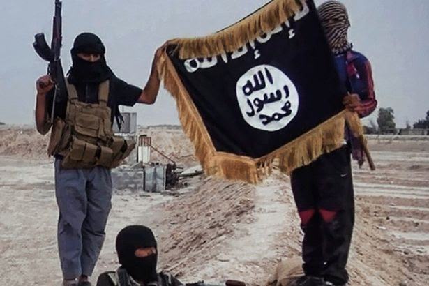Militants of the Islamic State of Iraq and the Levant (ISIL) posing with the trademark Jihadists flag