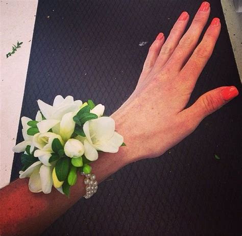 Wedding wrist corsage with white freesia.   The one with
