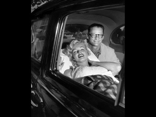 Monroe and her husband, Arthur Miller, smile as she leaves Doctors Hospital. But Marilyn was reported exhausted after losing her child.