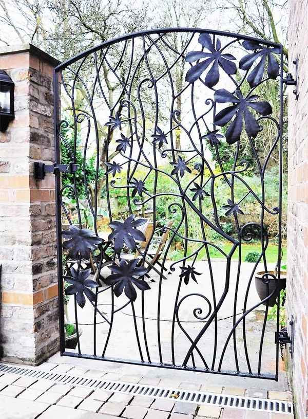 metal garden gates design ideas wrought iron gate leaves pattern 15 Decorative Metal Gate Design for Amazing First Impression