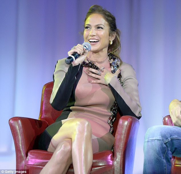 'S***, I think it just bit me!' J-Lo grabs onto her new friend as she speaks into the microphone
