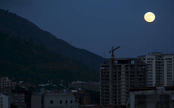 A supermoon, the last of this year's supermoons, rises in the sky in Caracas