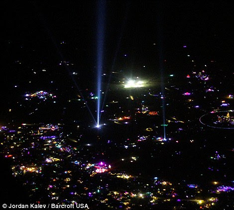 Lighting up the nights sky: The Burning Man extravaganza gets underway on Tuesday night after suffering from a 24 hour postponement on Monday due to an unexpected and rare deluge on Monday morning that saw police turn revelers away