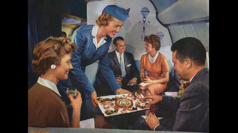 "In-flight canapes were regularly offered to the ""pearl set."" Uh-oh, it's the guy in the bow tie again. Let's hope he didn't take as long to choose his food as he did to make a chess move."
