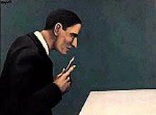 Magritte - Personagem meditando sobre a loucura