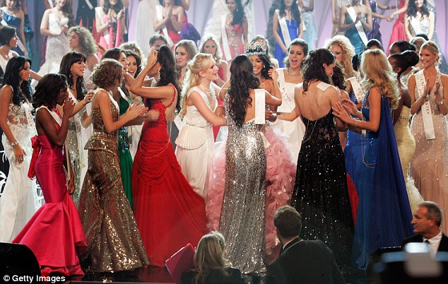 Ivian Sarcos, centre, pink dress, is congratulated by her fellow contestants