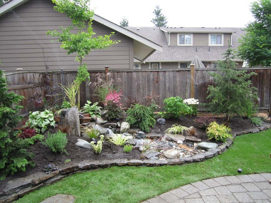 had a very small yard and wanted to have a peaceful nature filled yard - Back Yard Landscaping Ideas On A Budget Deck With Fire Pit Deck