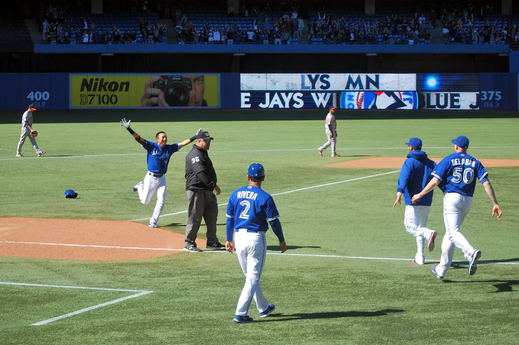 Kawasaki opens his arms in triumph after delivering the walk off hit.
