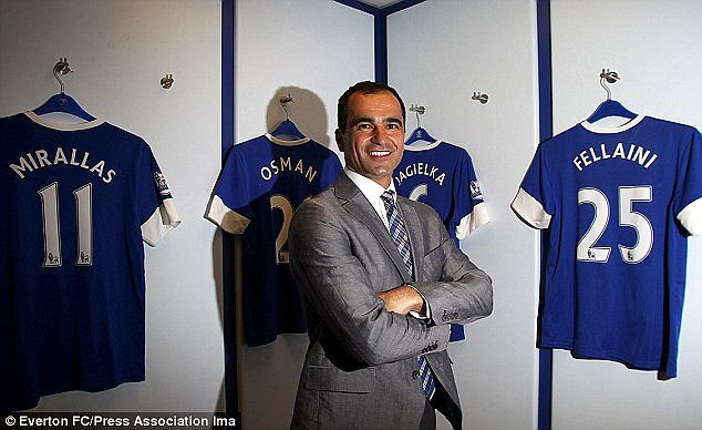 Martinez poses in the dressing room after his unveiling as Everton manager back in 2013