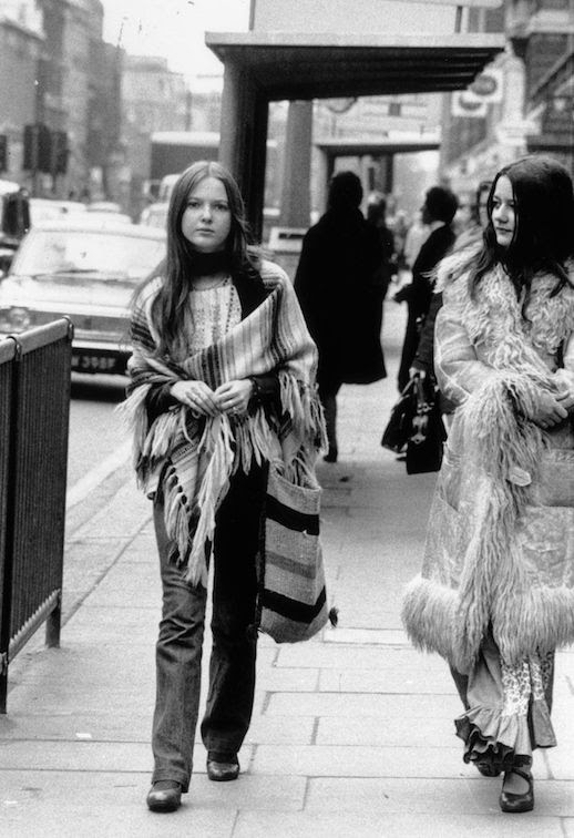Le Fashion Blog 1970s 70s Street Style Vintage Photos Stripe Poncho Shaggy Fur Coat Flared Denim Via Tres Blase