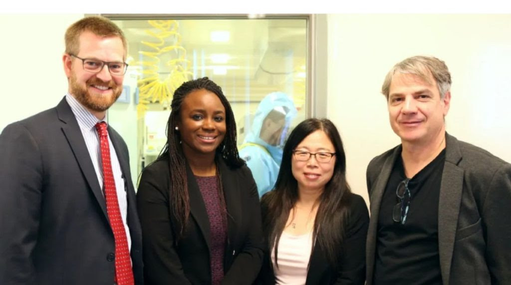 Dr. Xiangguo Qiu with her team at Canada's National Microbiology Laboratory
