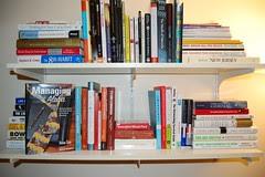 arranging books on the shelf