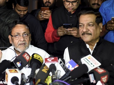 NCP leader Nawab Malik along with Congress leader Prithviraj Chavan addresses a press conference on Maharashtra government formation. PTI