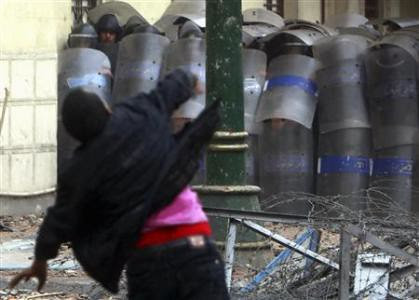 Protester throws stone at security forces who have attacked demonstrators since the beginning of December 2011. The North African state has been the scene of ongoing protest since January. by Pan-African News Wire File Photos