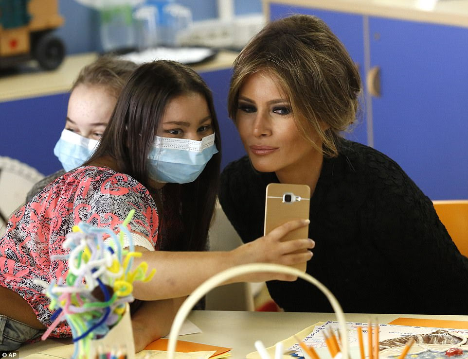 Image result for Melania looking at phone