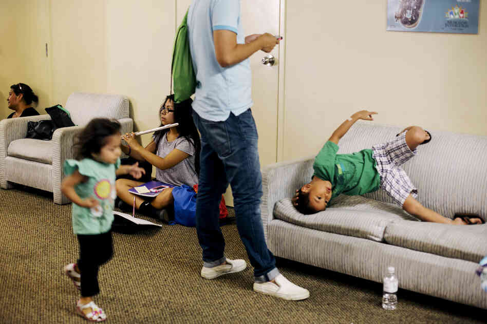While Harmony Project students head into their practice rooms, the second-floor hallway fills with parents and siblings who wait for an hour — reading books, playing video games, or entertaining each other.