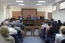 Judges attend the trial of urologist Lutfi Dervishi and his colleagues accused of organ trafficking, in Pristina