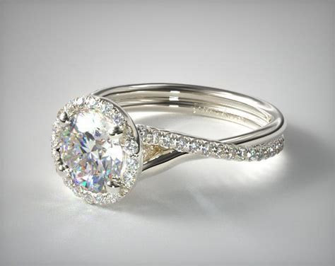 Pave Halo and Twisted Shank Diamond Solitaire   14K White