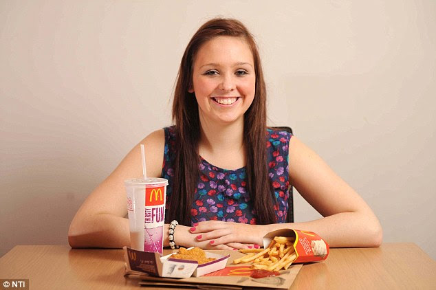 Disgusting diet: Miss Irvine with her beloved McNuggets, fries and a soda