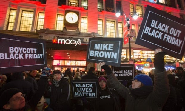 Black Friday : Protesters hold signs aloft outside Macy's - photo