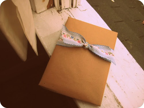 Brown paper packages tied up with (embroidered ribbon).