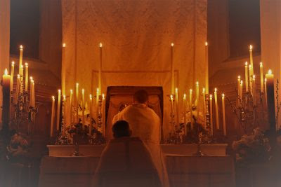 The Blessed Sacrament is placed in the Tabernacle at the Altar of Repose