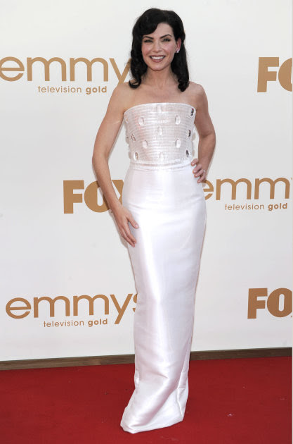 Julianna Margulies arrives at the 63rd Primetime Emmy Awards on Sunday, Sept. 18, 2011 in Los Angeles. (AP Photo/Chris Pizzello)