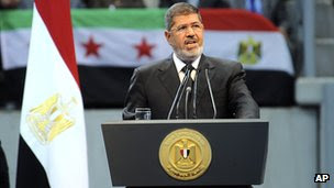 Egyptian President Mohammed Morsi addresses a rally in Cairo on 15 June  2013